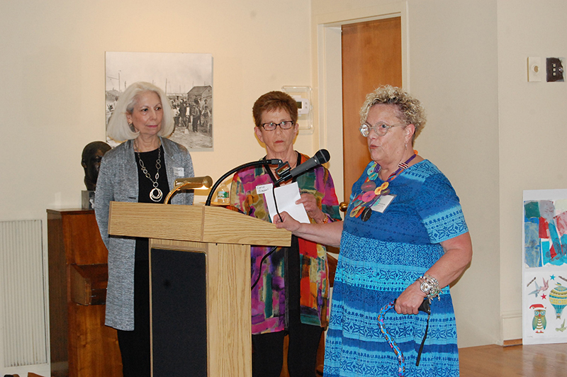 ARTIST KARLA SPEAKS TO THE GUESTS AT THE EXHIBITION OPENING WITH AFTA TEACHING ARTIST CAROL SIEGEL AND ELIZABETH LANE
