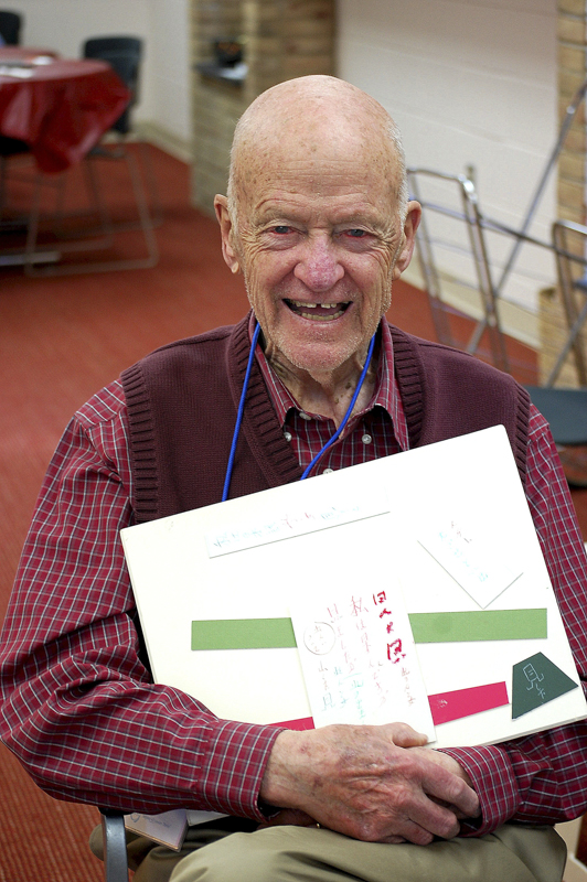 A PARTICIPANT WHO LEARNED JAPANESE IN WORLD WAR II INCLUDES JAPANESE CHARACTERS IN HIS COLLAGE.